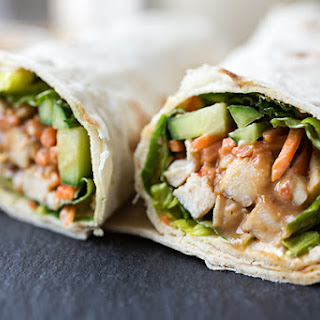 """Thai-Style Peanut Chicken """"Spring Roll"""" Wraps with Cool Greens, Cucumber and Carrots, drizzled with a Sweet & Spicy Peanut Sauce"""