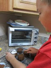 Photo: It that time. DMan frosting his Pumpkin Cupcake with the NEW Cool Whip Vanilla Frosting. The regular frosting we buy is thick and hard to spread not the NEW Cool Whip Frosting.
