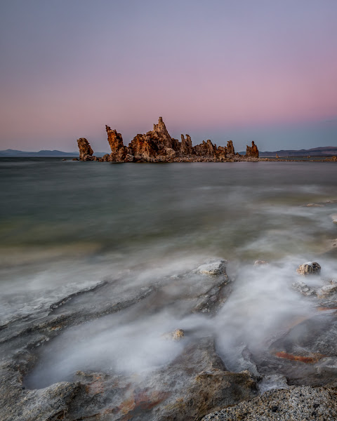 Photo: Belt of Venus sunset color as waves crash on the shore of Mono Lake.