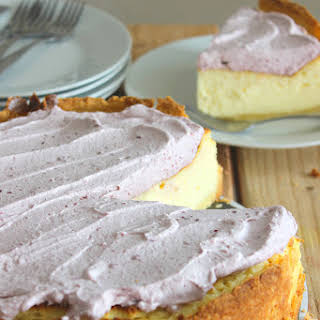 Vanilla Bean Cheesecake with Lemon Cookie Crust and Sour Whipped Cream Topping.