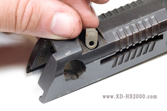 Photo: Once the rear sight is out of the way, remove the drop safety. Pay attention to its orientation.