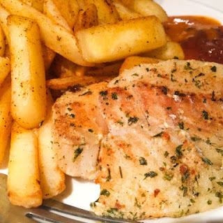 White Fish on Popiote with Oven Baked Chips.