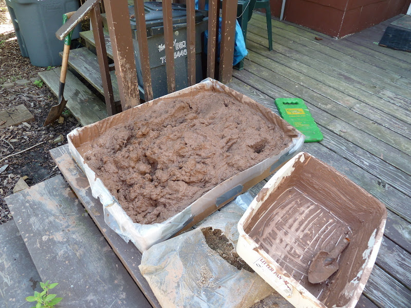 Photo: Clay chopped up with a spade, mixed with water and sand.
