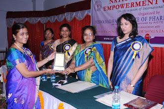 Photo: Dr. P. Uma Devi, Convener honoring Dr. K. Raja Rajeswari, Director and Guest of Honor