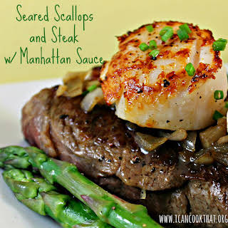 Seared Scallops and Steak with Manhattan Sauce.