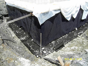 "Photo: ... vertical Platon seam sealed, drainage remediated: stone 4"" up the Platon & new fabric layed down ..."