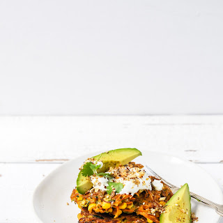 Carrot, Zucchini and Corn fritters with avocado, yoghurt and dukkah.