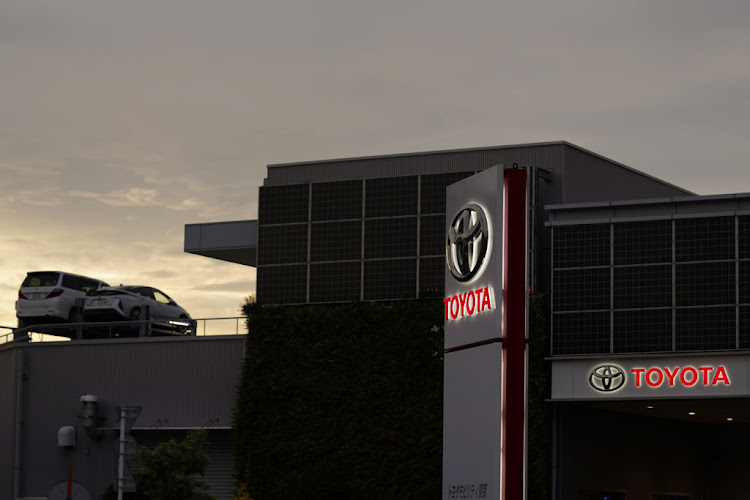 Japanese car makers' April sales halved