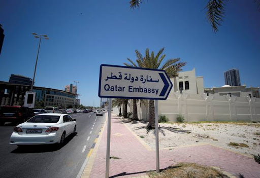 A sign indicating a route to Qatar embassy is seen in Manama, Bahrain, June 5, 2017.