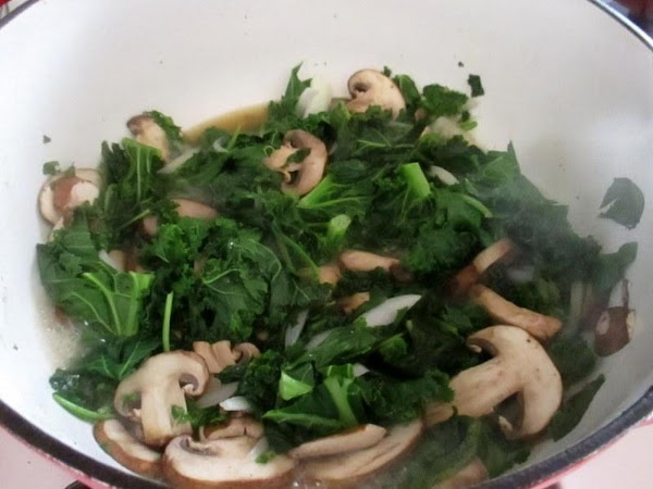 I did this in 2 batches, as it's a pot full until greens wilt.  Place...