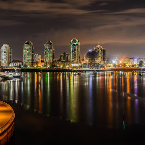 A riot of city colour by Cory Bohnenkamp - City,  Street & Park  Night ( shore, water, night, vancouver, colours, city )