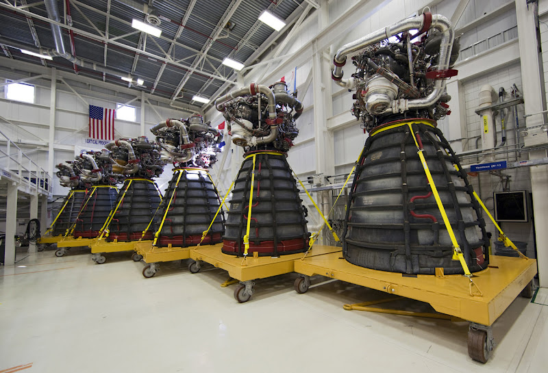 Photo: Lined up in a row, six Pratt & Whitney Rocketdyne space shuttle main engines sit on stands inside the Engine Shop at NASA's Kennedy Space Center on October 14, 2011. For the first time, all 15 main engines were in the Engine Shop at the same time. They were being prepared for shipment to NASA's Stennis Space Center in Mississippi for storage following the completion of the Space Shuttle Program. The engines are being repurposed for use on NASA's Space Launch System heavy lift rocket. (NASA/Dimitri Gerondidakis) - Via In Focus: http://theatln.tc/GXlgMp