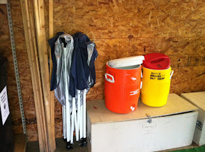Photo: Session number poles, canopy, water coolers
