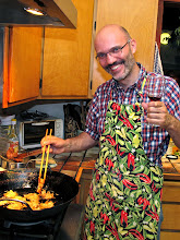 Photo: Giorgio frying pumpkin fritters while enjoying a glass of wine