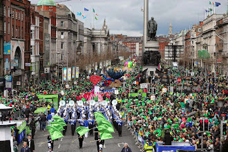 Photo: Thousands of people line the streets of O'Connell Street to watch the St Patrick's day parade in Dublin, Ireland, Monday March, 17, 2014.  The world's largest parade celebrating Irish heritage set off on a cold and gray morning, the culmination of a weekend of St. Patrick's Day revelry. (AP Photo/Peter Morrison)