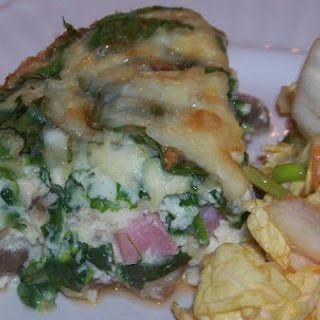 Cheesy Crustless Ham, Mushroom and Spinach Quiche.