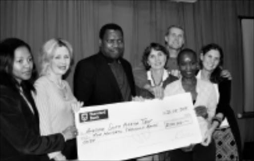 WINDFALL: MEC for finance Zweli Mkhize, centre, donates R500 000 to Awesome SA, the organisers of the Wonderful Women gathering. From left, Pam Zulu, Sandy Holley, Di Smith, Nosipho Mgojo, Candy Smith and Garth Braudseth. Pic. Mhlaba Memela. 26/08/08. © Sowetan.