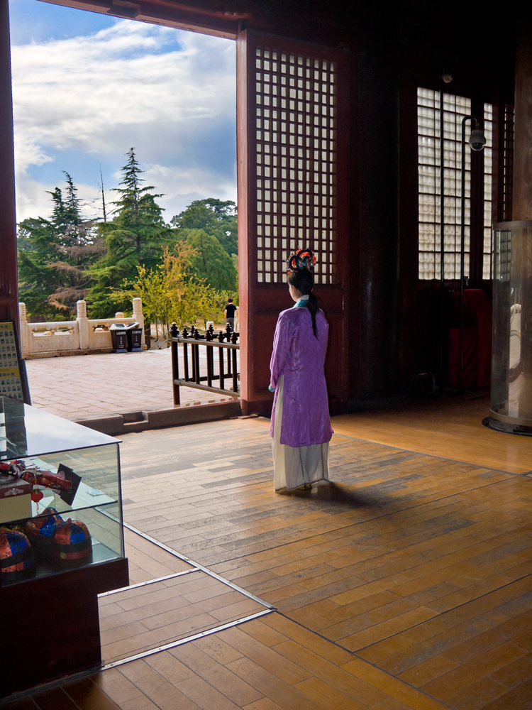 Photo: A young woman in period costume greets visitors to the Ming Tombs - Near Beijing - April 2009