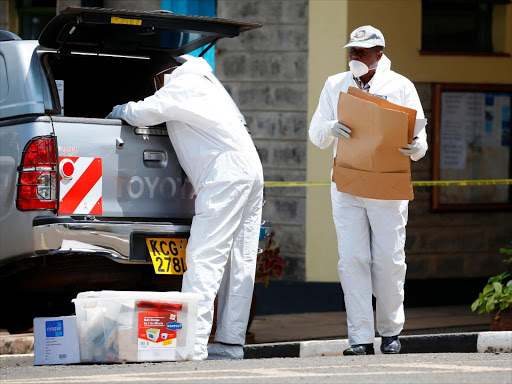 Officers from the DCI leave the Chiromo Mortuary on December 13, 2016 after collecting samples for DNA in an effort to Identify the victims of the Karai road tragedy to their relatives. /JACK OWUOR