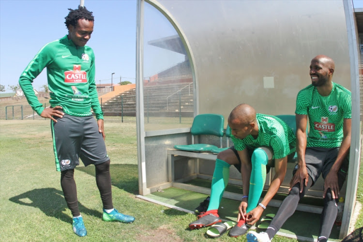 Percy Tau (L), who plays in the Belgium second division, shares a moment with his Bafana Bafana teammates Tiyani Mabunda (C) and Ramahlwe Mphahlele (R) during a training session at Princess Magogo Stadium in Durban September 04, 2018.