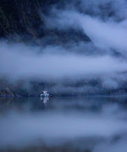 Photo: Sleeping on a boat in the fjord... waking up to a lazy blanket of blue fog...