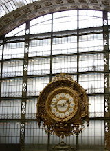 Photo: Huge clock at the Musée d'Orsay.  You can see the silhouettes of people walking behind it.