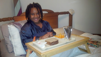 Photo: Kaleya gets treated to an in-bed meal