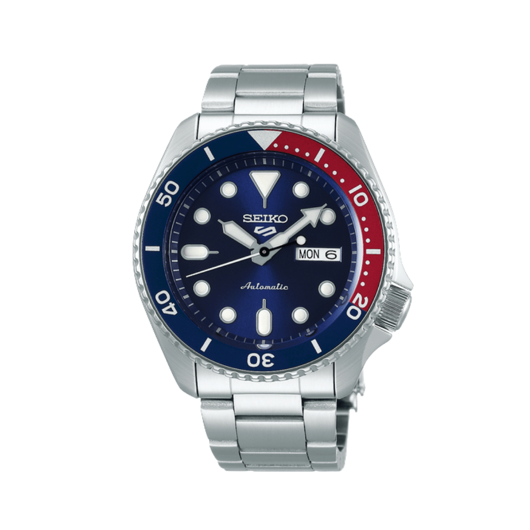 Silver steel seiko watch with a navy and red bezel.