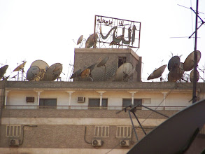 Photo: A lot of satellite dishes on the roof of a building or two.  This was a common sight.