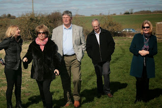 Photo: The Davies and the Dunns make their way forward to the helicopter