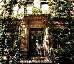 """Photo: """"Ensconced...""""  New York Photography: St. Mark's Place brownstone. East Village.   Before the leaves begin their gravity-fettered migration to the ground, the sun engages in one last embrace with the foliage ensconced shadows.  In these sun-soaked shadows, the leaves shiver while dreaming of winter's frigid kiss waltzing slowly with the ominous brisk breeze before they are swept off their branches like young lovers swept off their feet by the newness of each other.   You can view this post along with information about prints of this image if you wish at my site here:  http://nythroughthelens.com/post/12565844831/st-marks-place-brownstone-covered-in-lush-ivy    Tags: #photography #writing #prose #poetry #newyorkcity #newyorkphotography #nyc #eastvillage #brownstone #architecture #ivy"""