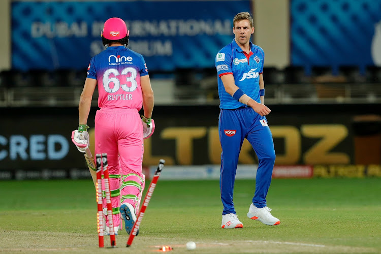 Delhi Capitals fast bowler Anrich Nortje gives Jos Buttler of Rajasthan Royals the hairy eyeball after bowling him with the fastest delivery ever in the IPL at the Dubai International Cricket Stadium, October 14, 2020