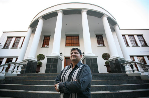 Atul Gupta at the bottom of the steps to his Saxonwold, Johannesburg home. Picture: SUNDAY TIMES