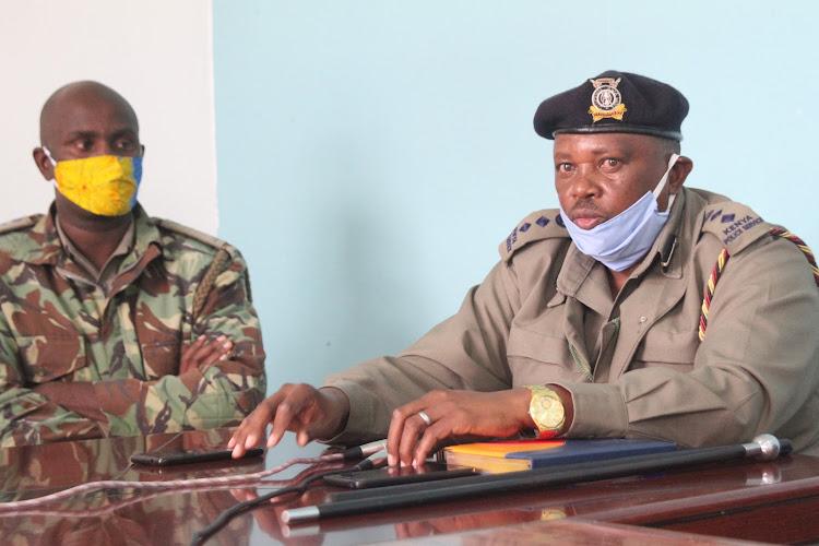 Baringo Central police commander Francis Gachoki and Kabarnet police station OCS Andrew Kivindyo address journalists on Wednesday
