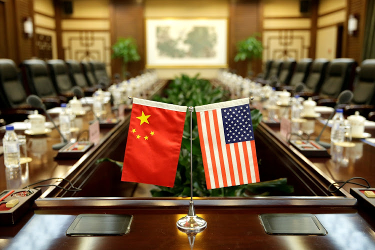 US and China flags ahead of a meeting in Beijing, China. Picture: REUTERS/JASON LEE
