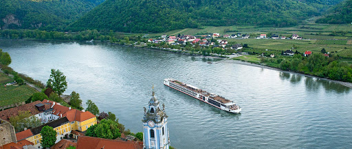 Aerial view of a Viking Njord sailing past Dürnstein, Austria, along the Danube River.