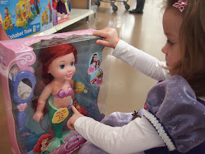 Photo: I decided that we should head to the front of the store where there was a second section of holiday toys. Perhaps at least we would find those Mattel toys up there? On the way, Darah spotted, you guessed it, Ariel.