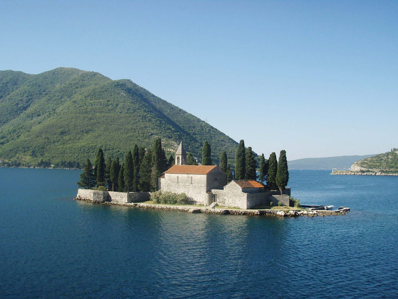 Visit a tiny island church with hidden Baroque art in Kotor, Montenegro.