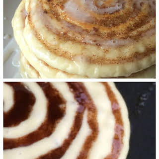 Homemade Cinnamon Roll Pancakes with cream cheese glaze.
