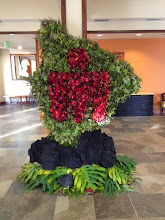 Photo: Floral arrangement w/the Ironman logo inside the island of Hawai'i