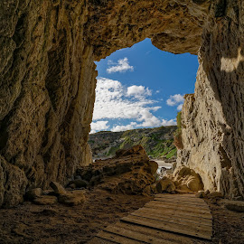 walk-in cave by Peter Schoeman - Landscapes Caves & Formations ( clouds, sky, pathway, cave, africa, hermanus, western cape )