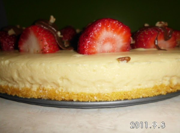 Cut strawberries in half, lay on top of cheesecake.