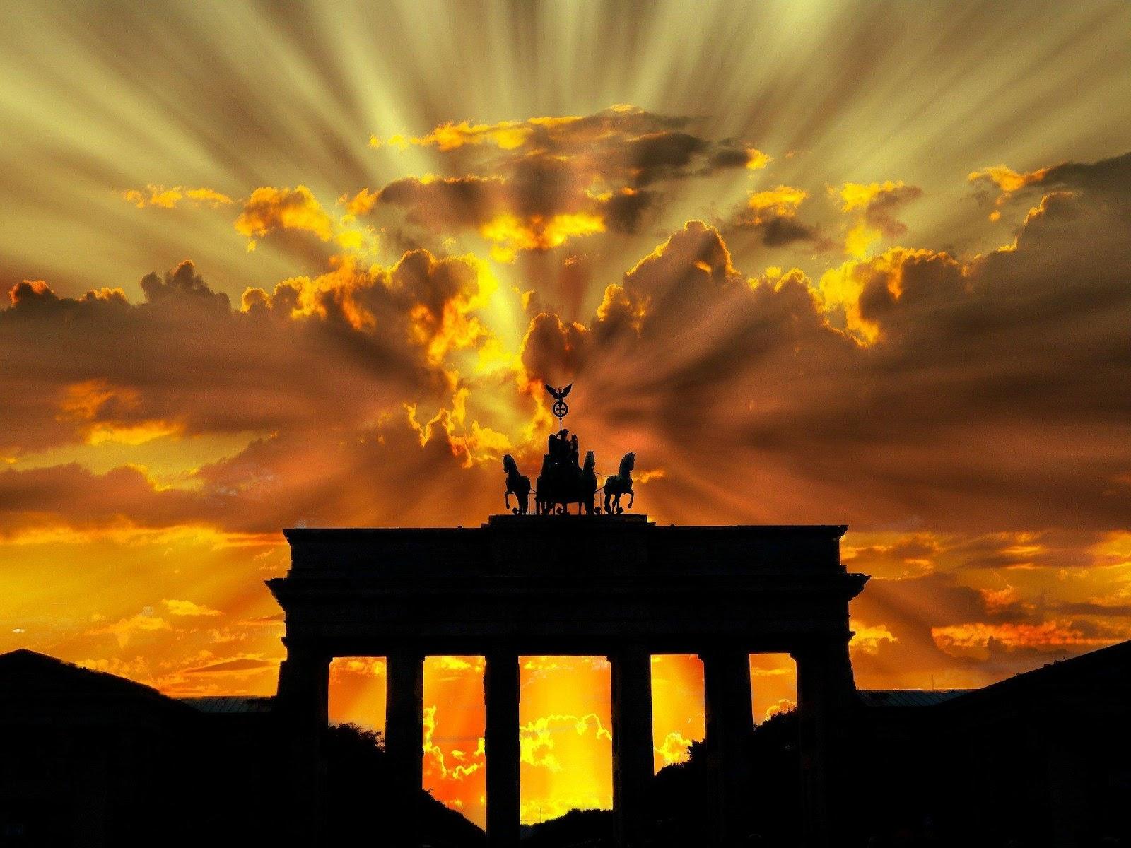 sun rays over monument