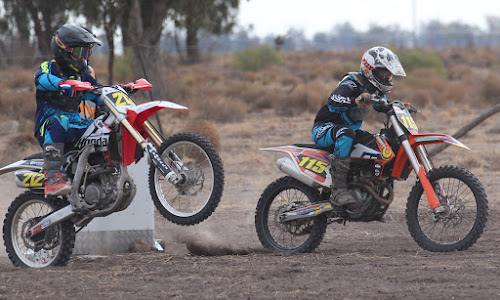Tyson Holley and Michael McDougall take off from the starting line on Saturday in round one of the grass track season.