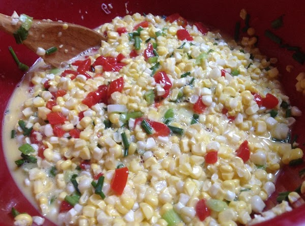Now add corn green onions and chive, & mix till combined.