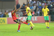 Luther Singh of SA and Natael Masuekama of Angola during the International friendly match between South Africa and Angola at Buffalo City Stadium on March 28, 2017 in East London, South Africa.