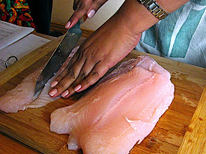 Photo: cutting basa fillets for ginger-tamarind fish soup
