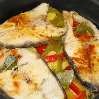 Corvina (Sea Bass) in the pan.