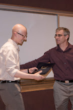 Photo: Tim Campbell accepting the Eugene L. Lawler Prize.