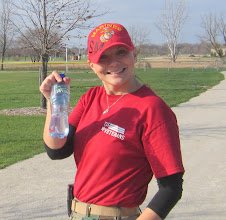 Photo: Anna Sourile from Run 4 Vets shows the power water that is going to be a great sponsor for next years Run 4 Vets event.